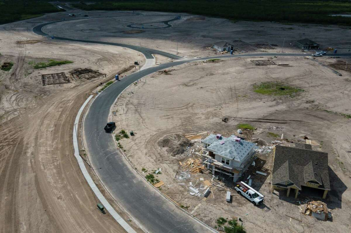 New homes are constructed Tuesday, June 15, 2021, in Brownsville.