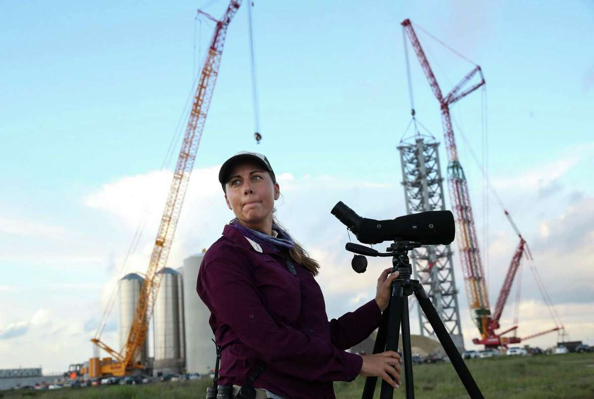 """Stephanie Bilodeau, a coastal bird biologist known to SpaceX security as the """"bird lady,"""" looks for plover nests on mudflats near the SpaceX launch facility being built on Thursday, June 17, 2021, near Brownsville. """"It just concerns me a bit, what that's going to look like and how that's going to impact the birds nesting out here,"""" she said. """"There's a reason they want to nest here, and it's just unfortunate if they're forced to move elsewhere."""""""