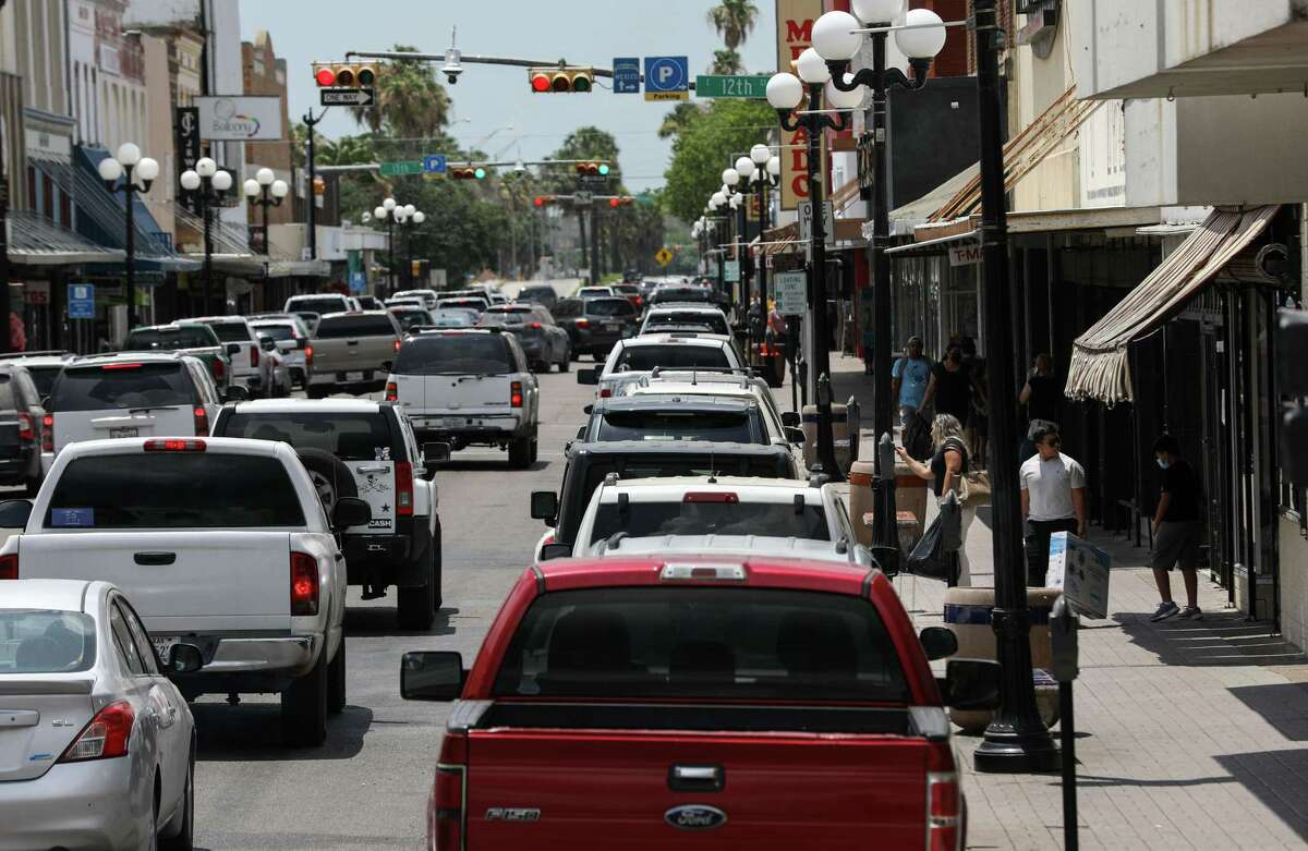 People shop and drive Tuesday, June 15, 2021, in downtown Brownsville. Investment in the area picked up as SpaceX continued to build rocket-launch facilities nearby in an unincorporated area known as Boca Chica.