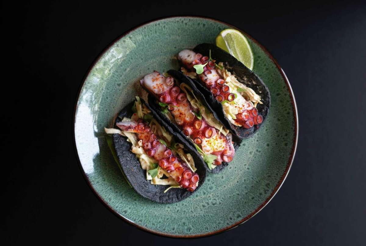Octopus tacos on squid ink tortillas, an ode to calamares en su tinta, a Spanish dish.
