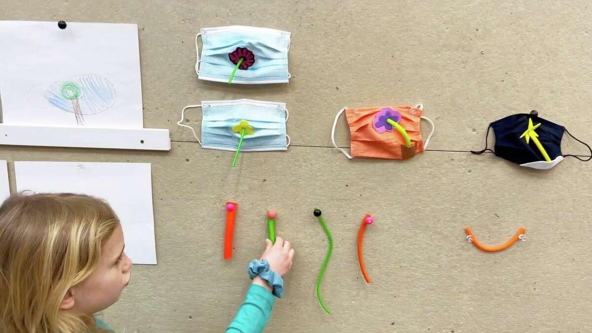 Chester first-grader Liv Ziemann demonstrates her Drink-O-Mask.