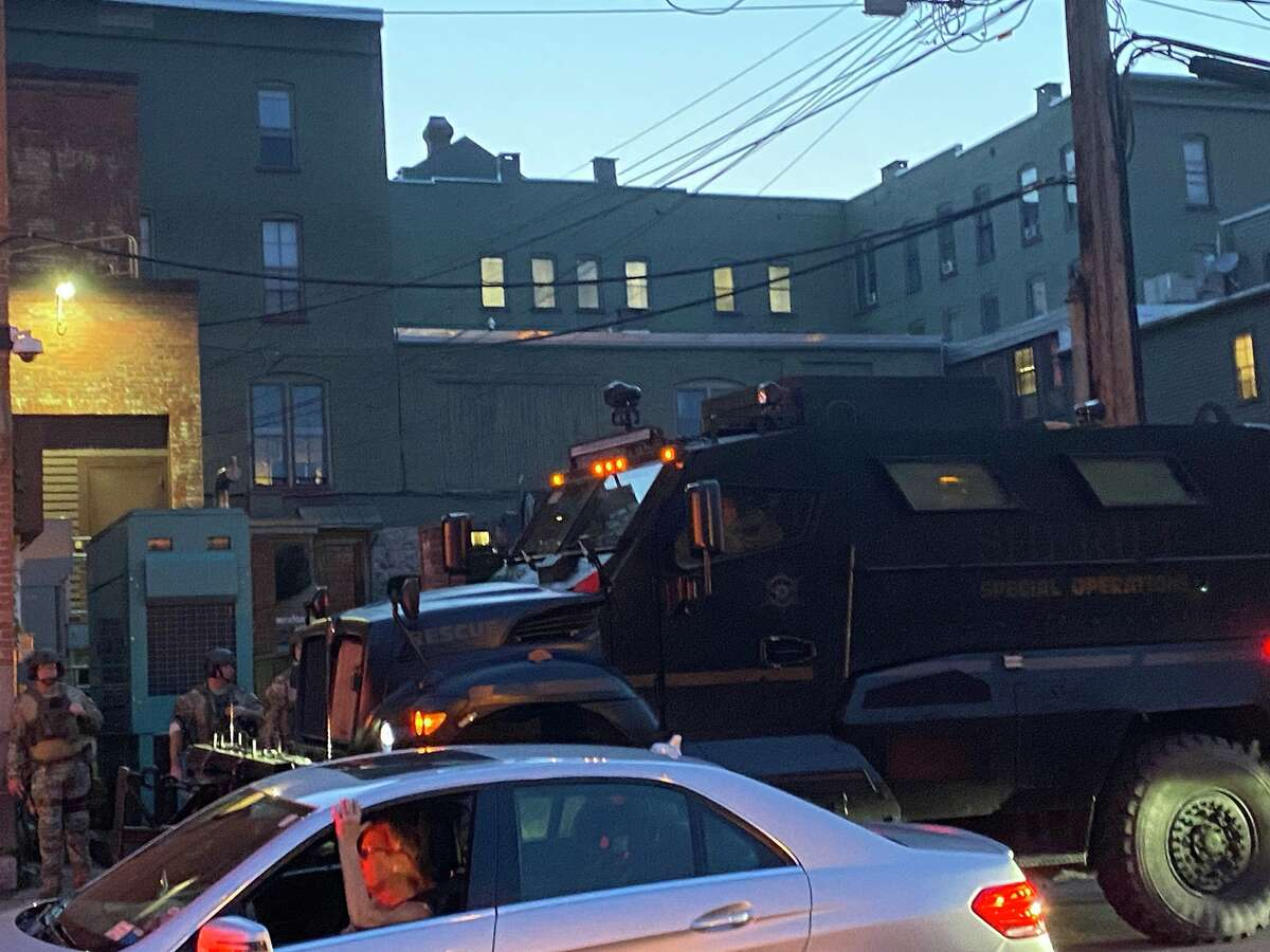 Saratoga County sheriff's deputies arrive in an armored vehicle Wednesday as Black Lives Matter demonstrators protested on nearby streets.
