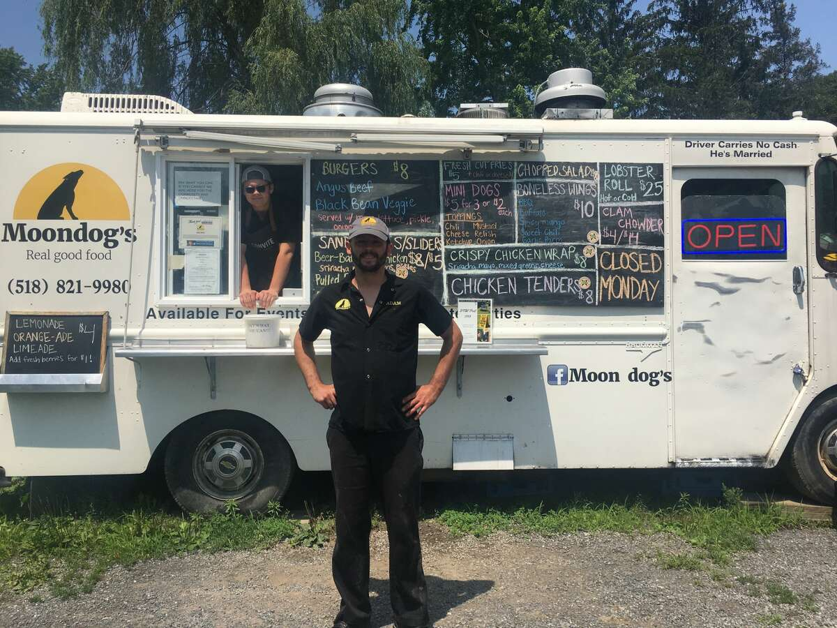 """Adam Moon (center) began a """"pay what you can"""" program at his Chatham food truck for those in need during the pandemic using a donation from his friend. He thought the money would cover two weeks of free food, but paying customers have been so willing to foot the bill for complimentary meals, the initiative is still going strong."""