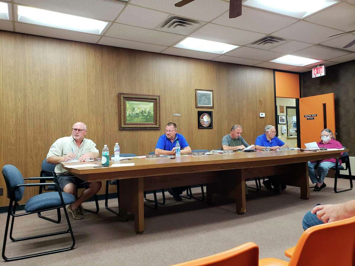 Caseville City Council members talk during their monthly meeting, where they approved a road millage renewal request for the November 2021 ballot. The council also approved a raise in the city's garbage collection rates. (Robert Creenan/Huron Daily Tribune)