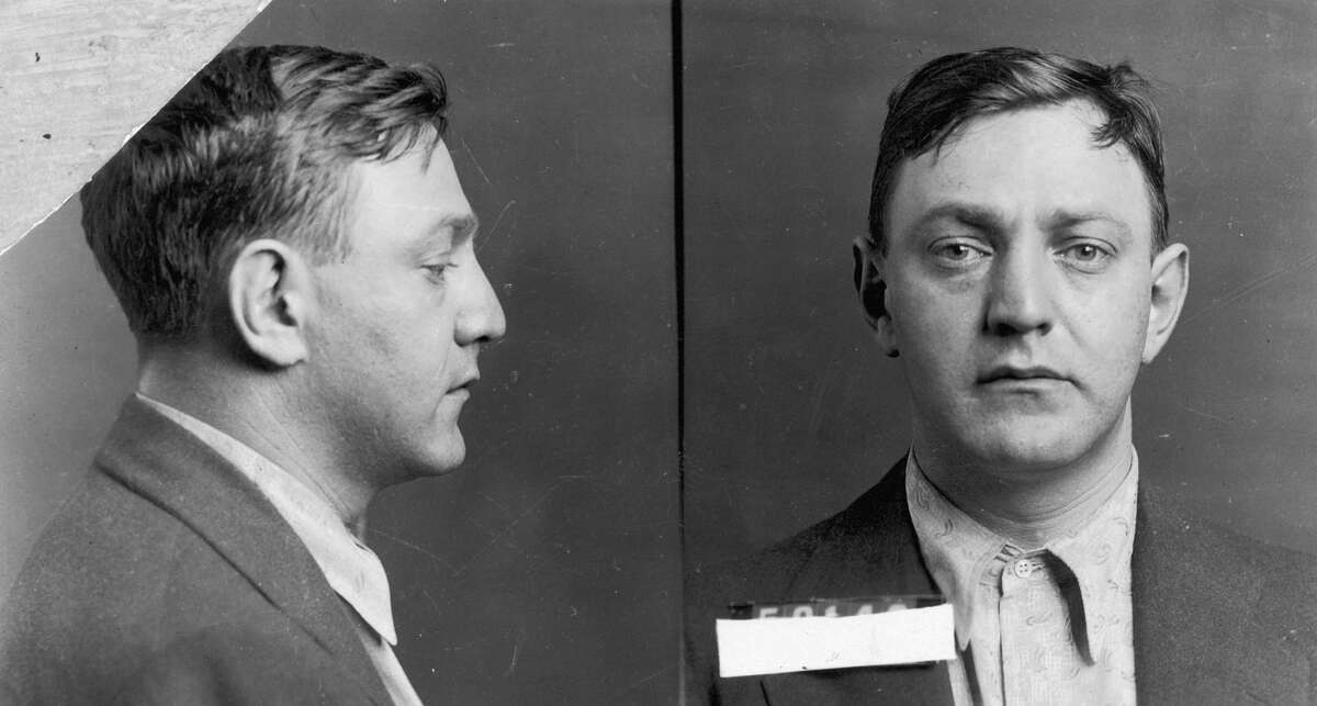 Mobster Dutch Schultz, shown here in a 1935 mugshot, had a big reputation as a bootlegger and racketeer in the 1920s and 1930s. But it was his last incoherent ramblings about buried millions that got the most attention, as they still fuel treasure hunts to the Catskills more than 85 years later.