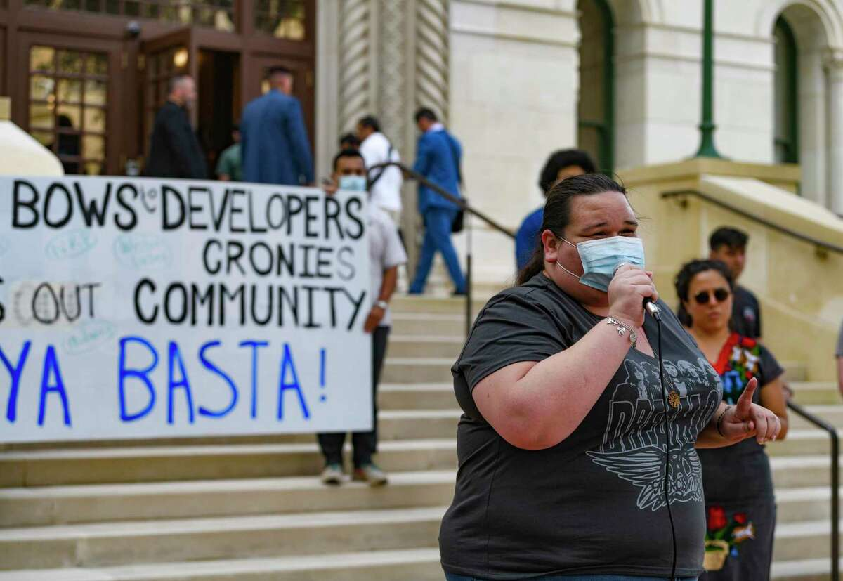 Kayla Miranda, a housing advocate who lives in public housing, speaks during a news conference at City Hall on Wednesday.
