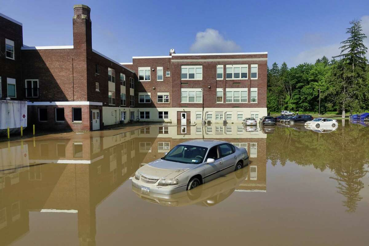 This month is the third wettest July on record in the Albany area. During the month, the region was hit with waves of thunderstorms that caused a variety of problems. This photograph shows vehicles in a flooded parking lot at Homeroom Lofts on Thursday, July 15, 2021, in Averill Park. (Paul Buckowski/Times Union)