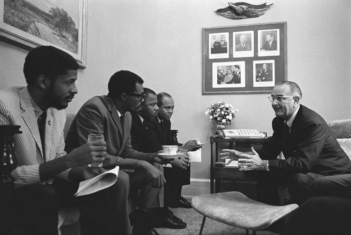 John Lewis, third from left, and other civil rights leaders meet in 1965 with President Lyndon B. Johnson before signing the Voting Rights Act.