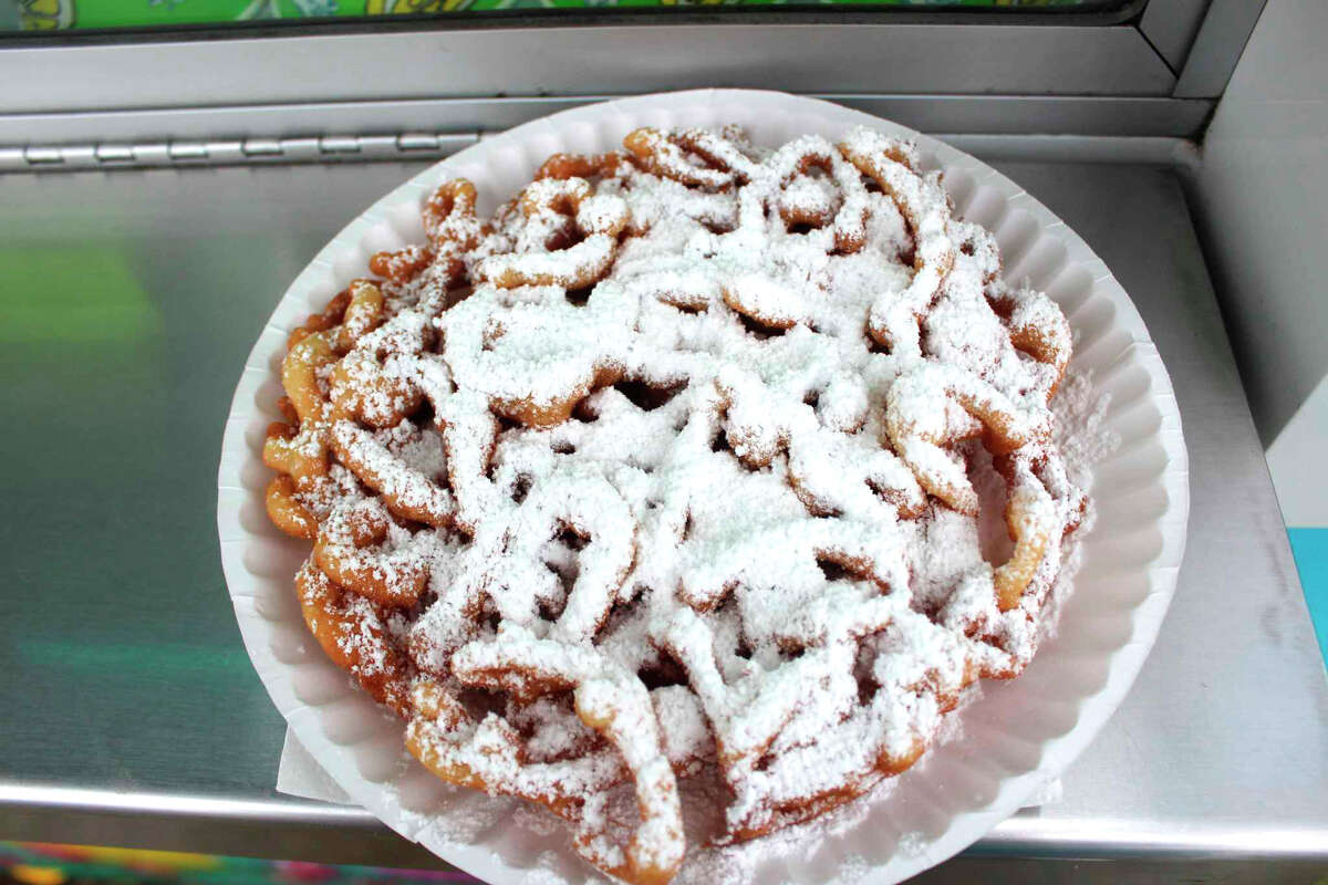 A traditional funnel cake with powdered sugar topping.
