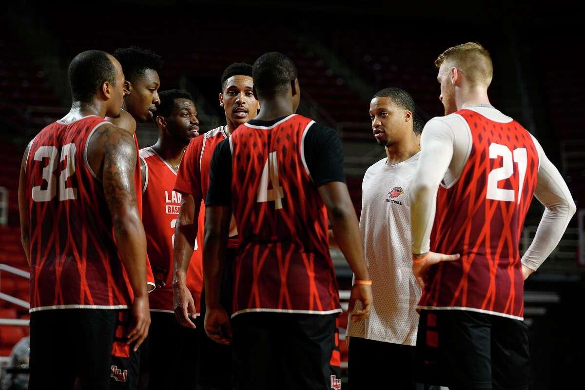 Lamar men's basketball assistant coach Justin Bailey talks with the players during practice on Thursday. Photo taken Thursday 8/10/17 Ryan Pelham/The Enterprise