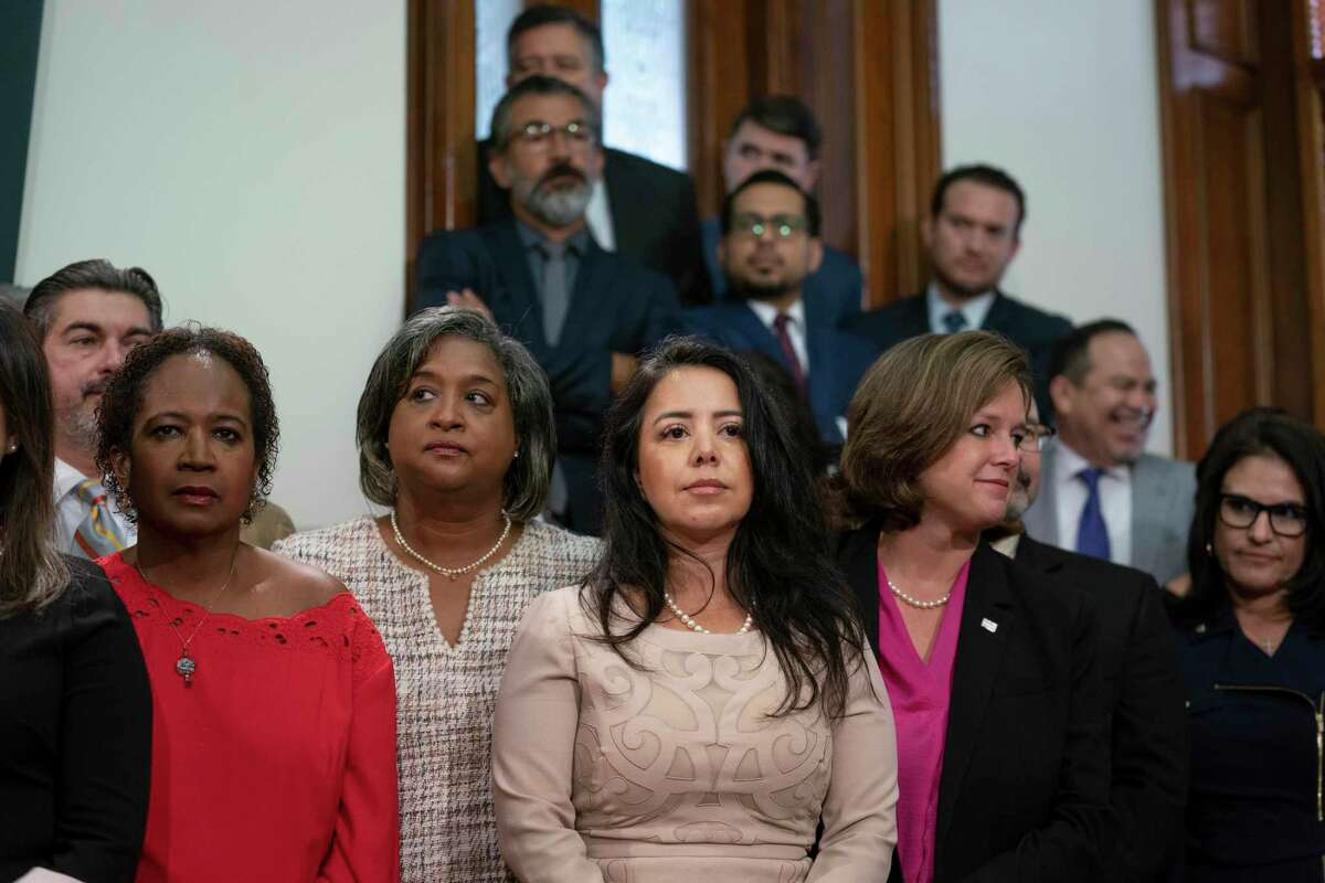 Democratic State Reps. Cheryl Cole, D-Austin, Rhetta Bowers, D-Rowlett, Victoria Neave, D-Dallas, and Rep. Ann Johnson, D-Houston, listen to the press conference on the first day of the special session on July 8, 2021.
