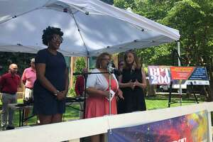 Bridgeport East Side Neighborhood Revitalization Zone President Kim Bianca Williams, City Council President Aidee Nieves, and Barnum Museum Executive Director Kathy Maher at a July 15, 2021 event in McLevy Green announcing a free concert and fireworks show as part of the city's bicentennial celebration.