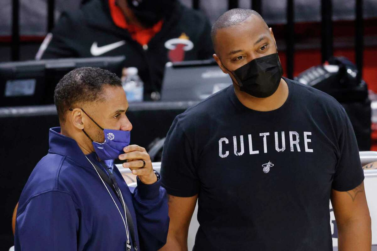 General manager Troy Weaver of the Detroit Pistons talks with assistant coach Caron Butler of the Miami Heat prior to the game at American Airlines Arena on January 16, 2021 in Miami, Florida.
