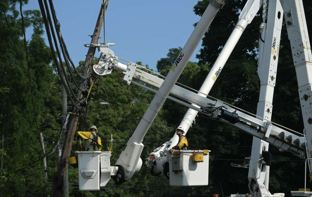 Eversource Energy crews repair damage to utility lines following Tropical Storm Isaias in August 2020.