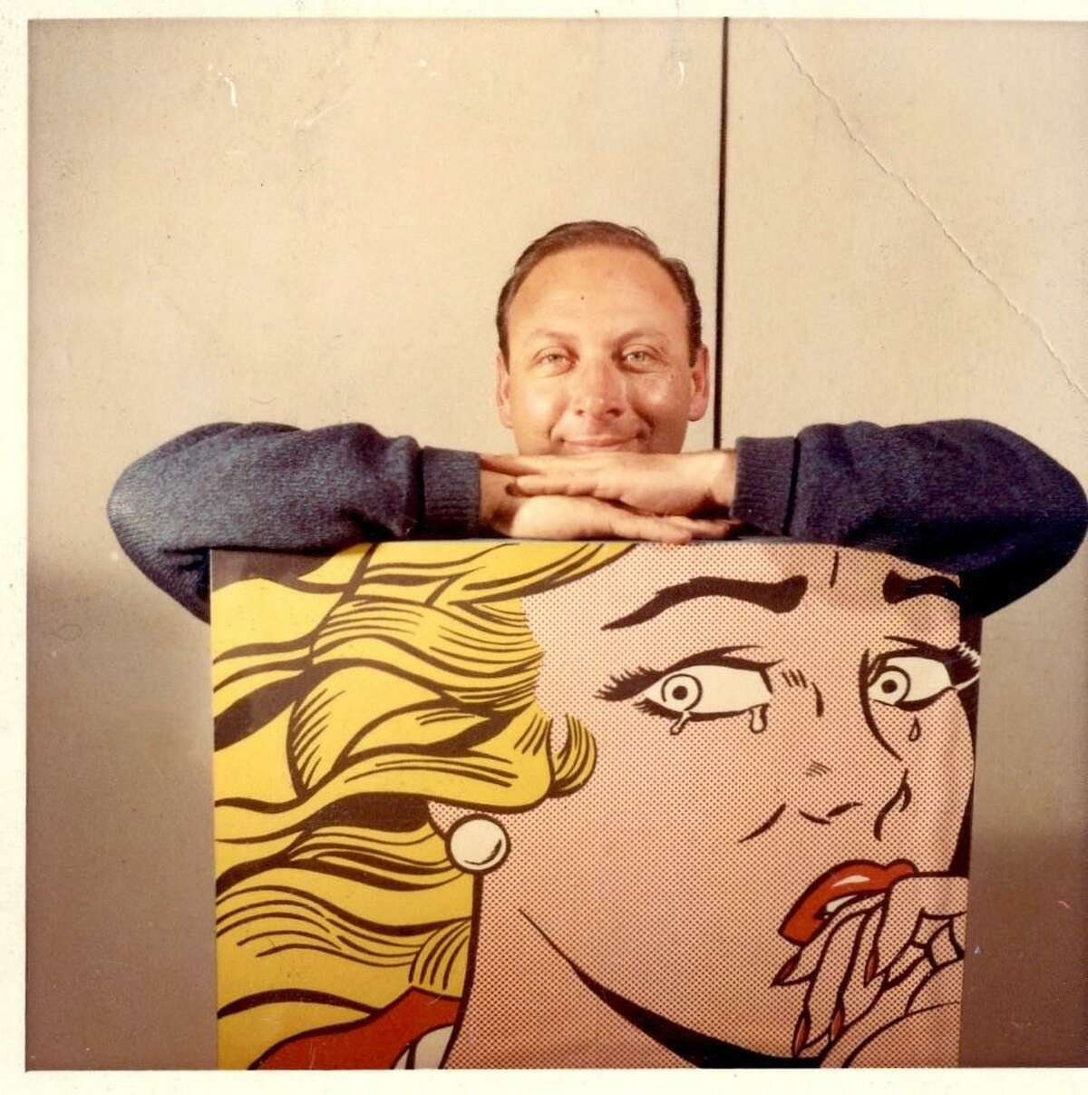 Ted Cohen with a reproduction of Crying Girl by Roy Lichtenstein.