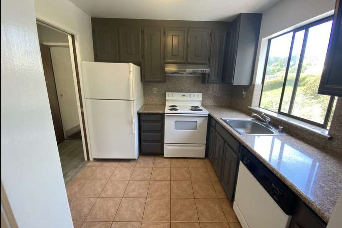 The kitchen looks like it has a dishwasher and a large window over the sink.