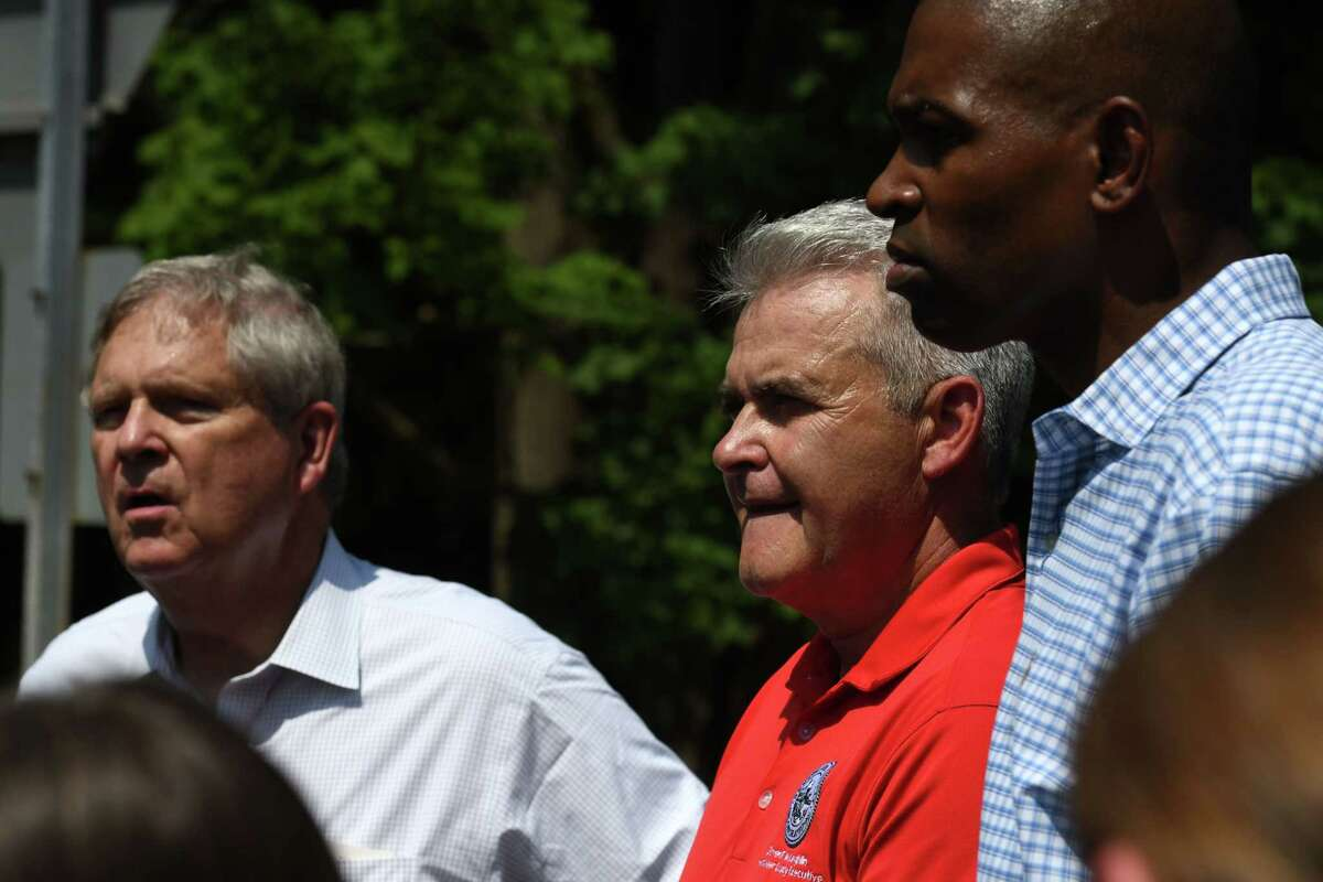U.S. Agriculture Secretary Thomas Vilsack, left, Rensselaer County Executive Steve McLaughlin, center, and U.S. Rep. Antonio Delgado, right, examine storm damage at Taborton Road on Thursday, July 15, 2021, in Sand Lake, N.Y. (Will Waldron/Times Union)