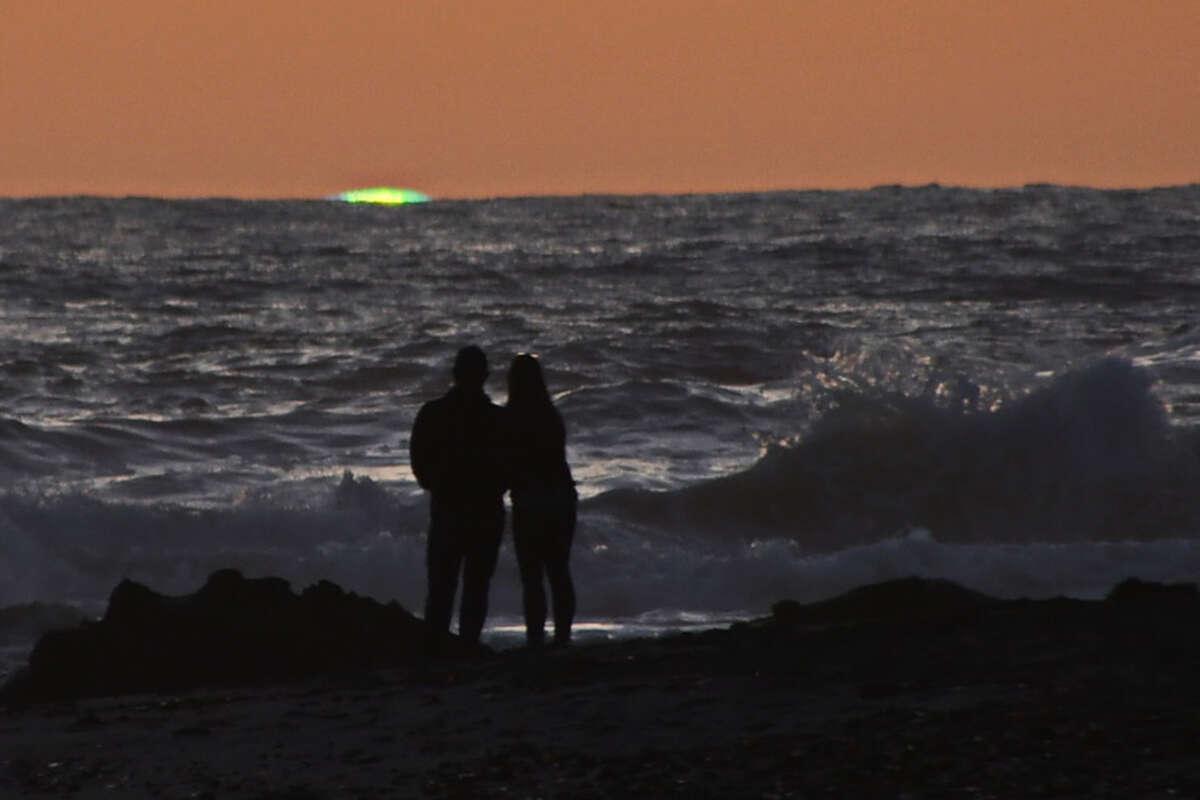 An inferior-mirage green flash is taken at Mavericks Beach at Pillar Point near Half Moon Bay.