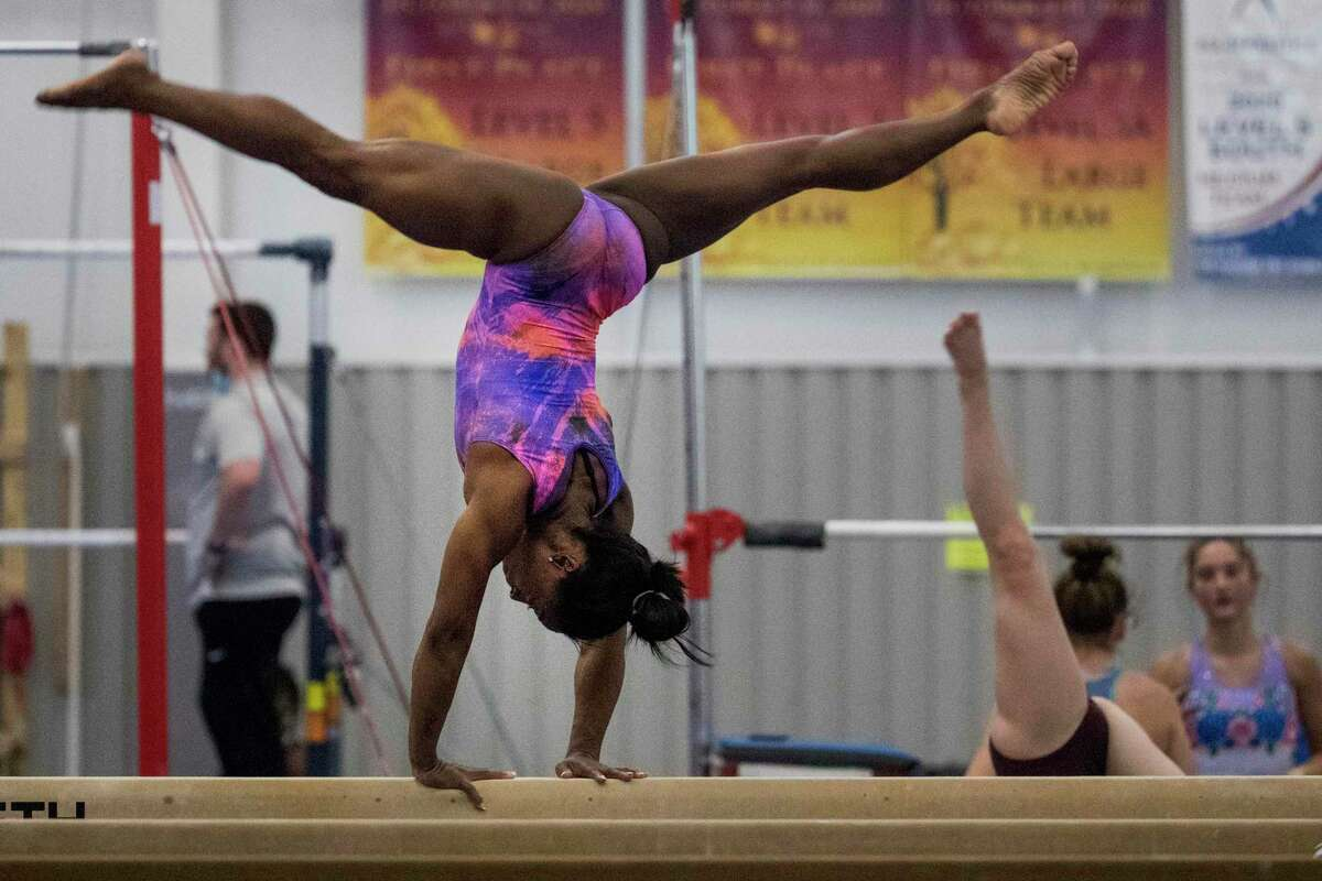 Olympic gymnast Simone Biles works on the balance beam as she prepares for the upcoming Tokyo Olympics at World Champions Centre Tuesday, July 6, 2021 in Spring.
