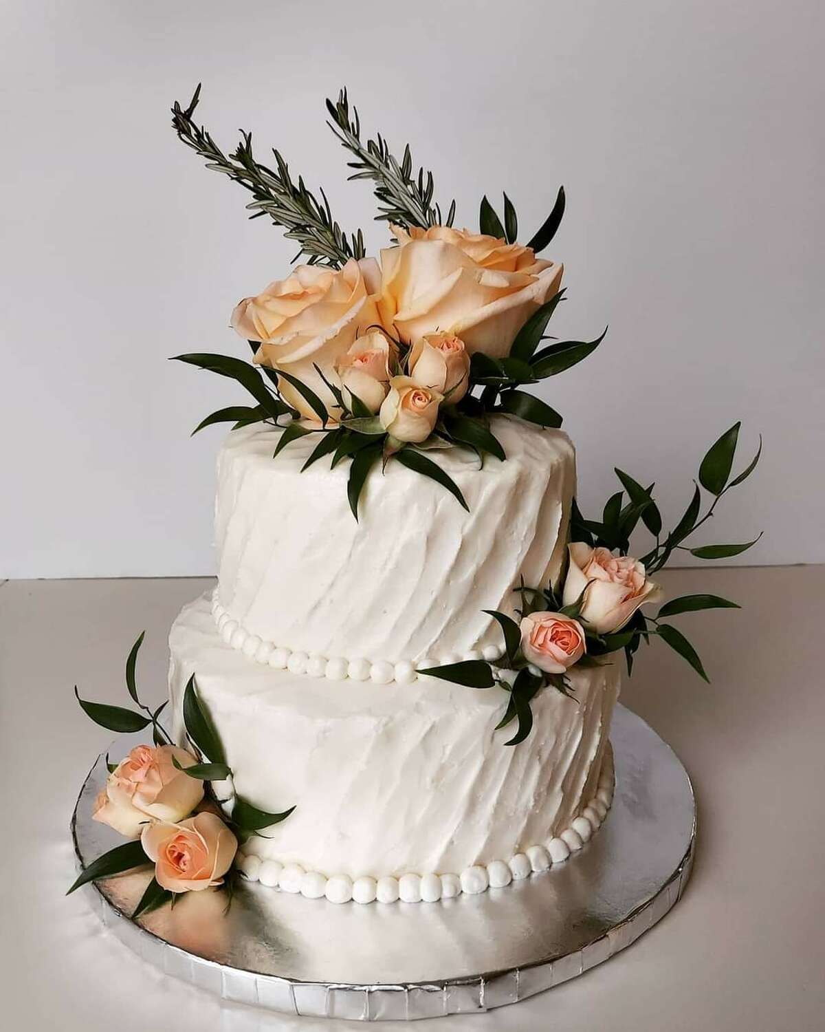 This beautiful cake was for a vow renewal ceremony in the beginning of July 2021.   Baked by Kari Santos.