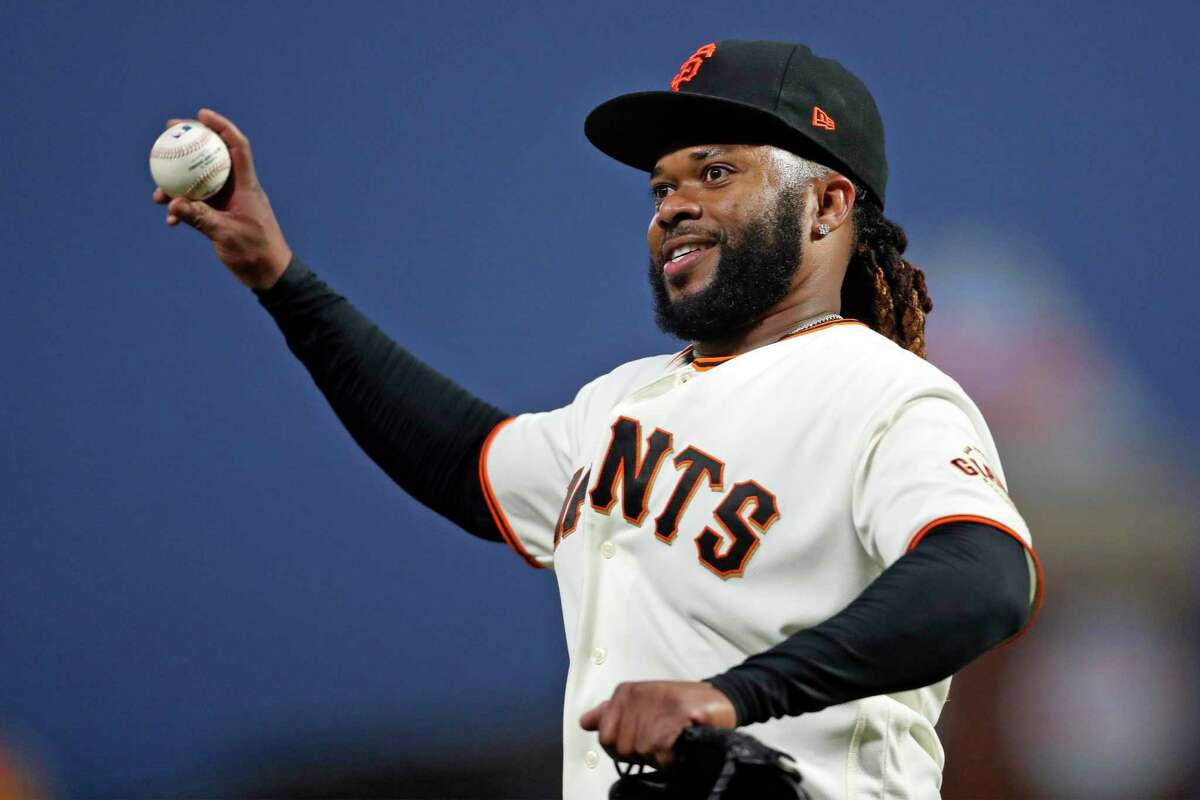 San Francisco Giants' Johnny Cueto readies to throw the ball into the crowd after end of top of 6th inning against St. Louis Cardinals during MLB game at Oracle Park in San Francisco, Calif., on Tuesday, July 6, 2021.