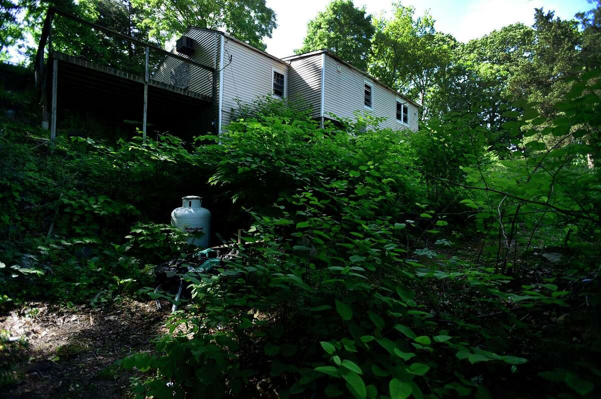An abandoned lot at 176 Bouton Street Tuesday, May 25, 2021, in Norwalk, Conn. The Norwalk Planning Commission has approved an application to split the property into five new residential lots.