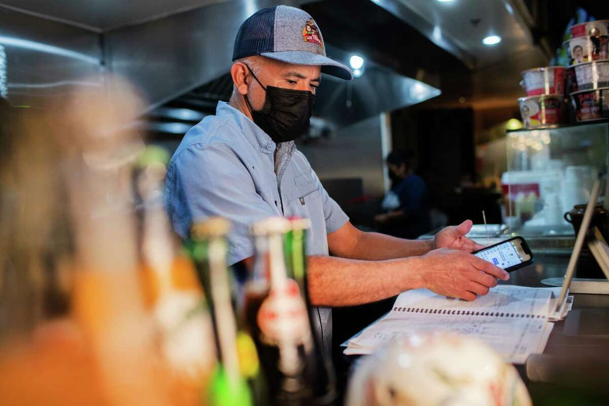 Birria Los Primos owner Oscar Garcia revises his agenda while working on his business, Thursday, July 15, 2021, in Houston. The management of the restaurant says Uber Eats has ripped them off to the tune of $20K.