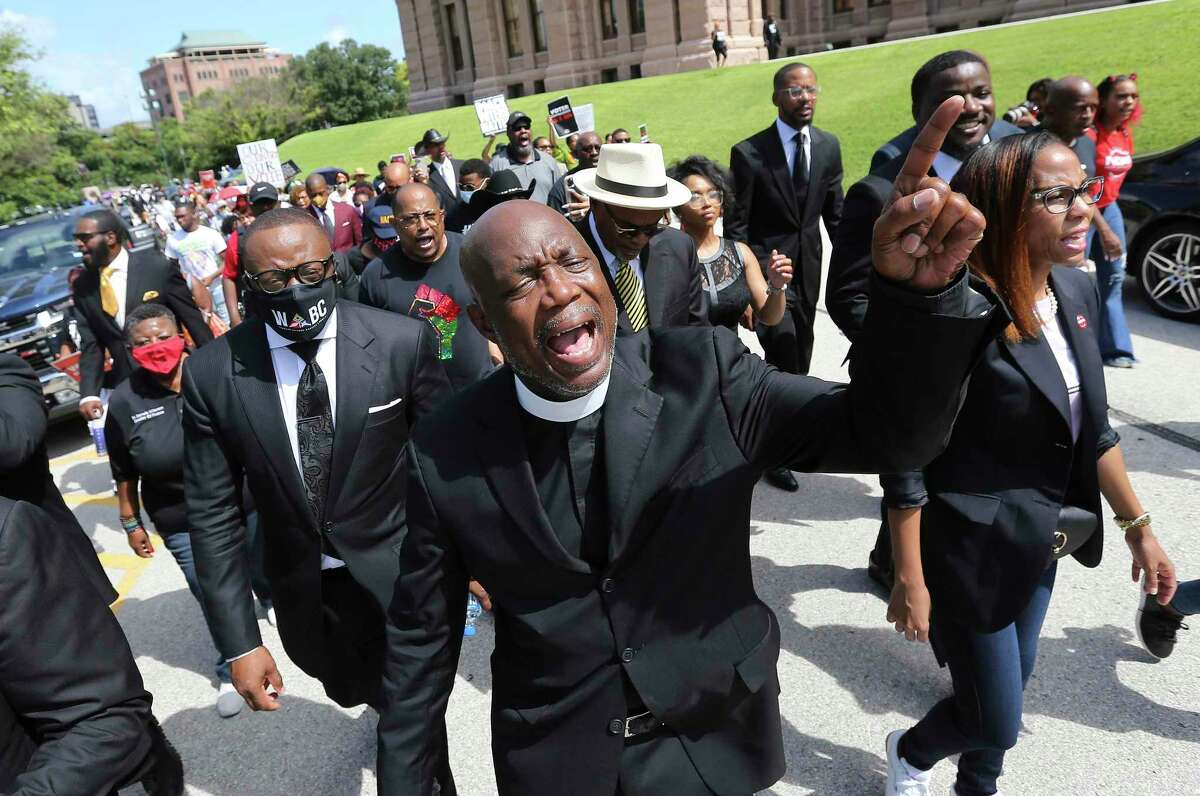 Dr. James Dixon, II, Bishop of Community of Faith of Houston helps lead a march of a large group of clergy and their supporters from around the state gather at the Texas Capitol to make a plea to legislators and to Gov. Greg Abbott about voting rights on Thursday, July 15, 2021. Several hundred people prayed and later marched around the Capitol to show their displeasure over recent voting rights legislation. Clergy also placed a letter at the door of the governor's office to request a visit with Gov. Abbott to discuss the legislation.