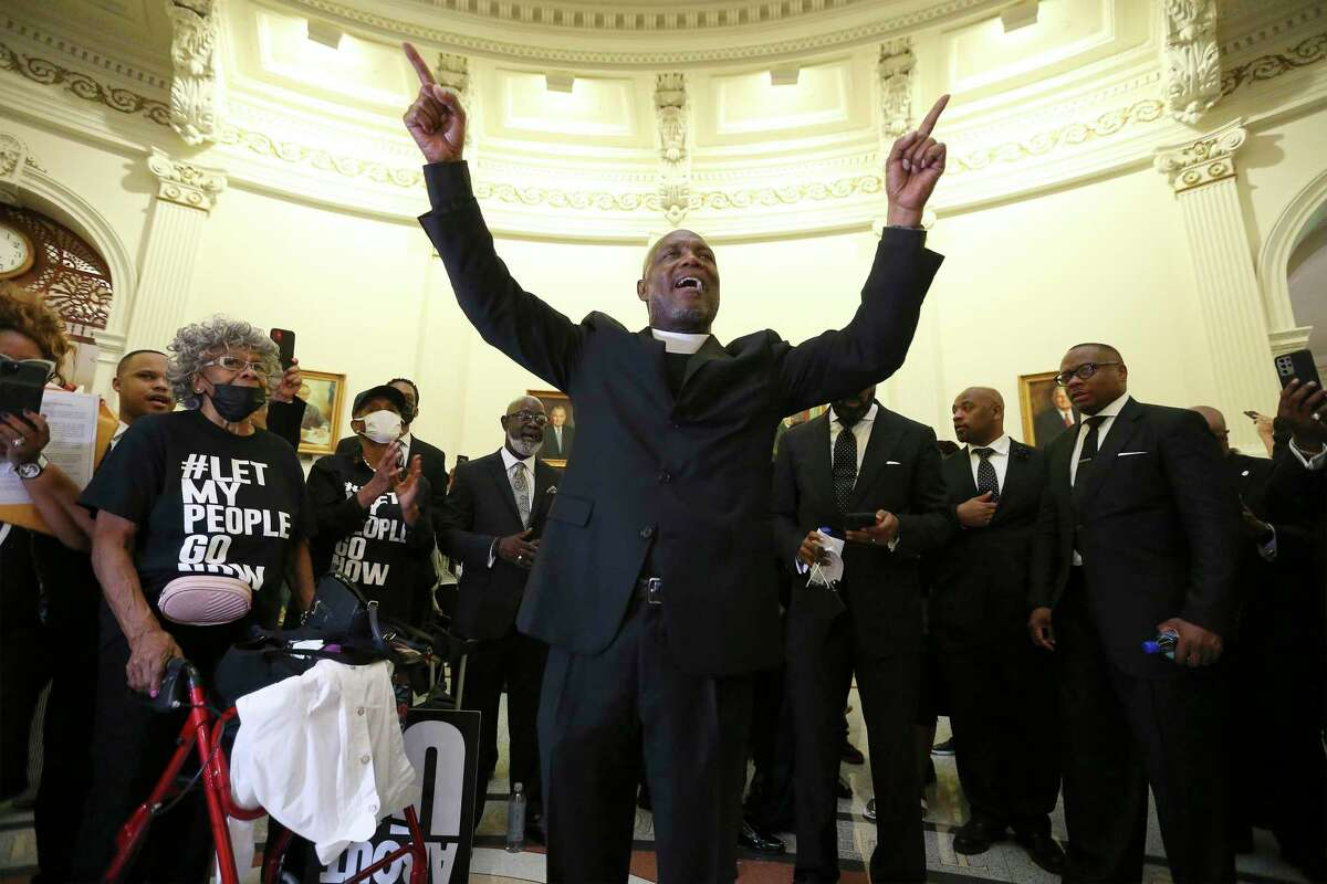 Dr. James Dixon, II, Bishop of Community of Faith of Houston leads during the singing of a gospel hymn as a large group of clergy and their supporters from around the state gather at the Texas Capitol to make a plea to legislators and to Gov. Greg Abbott about voting rights on Thursday, July 15, 2021. Several hundred people prayed and later marched around the Capitol to show their displeasure over recent voting rights legislation. Clergy also placed a letter at the door of the governor's office to request a visit with Gov. Abbott to discuss the legislation.