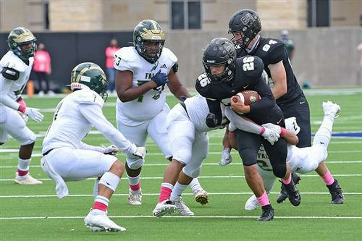 Members of the Cypress Park and Cypress Falls high school varsity football teams meet during a District 16-6A matchup at Cy-Fair FCU Stadium in 2020. Season tickets for the Tigers, Eagles and other CFISD varsity teams are eligible for renewal beginning July 19.