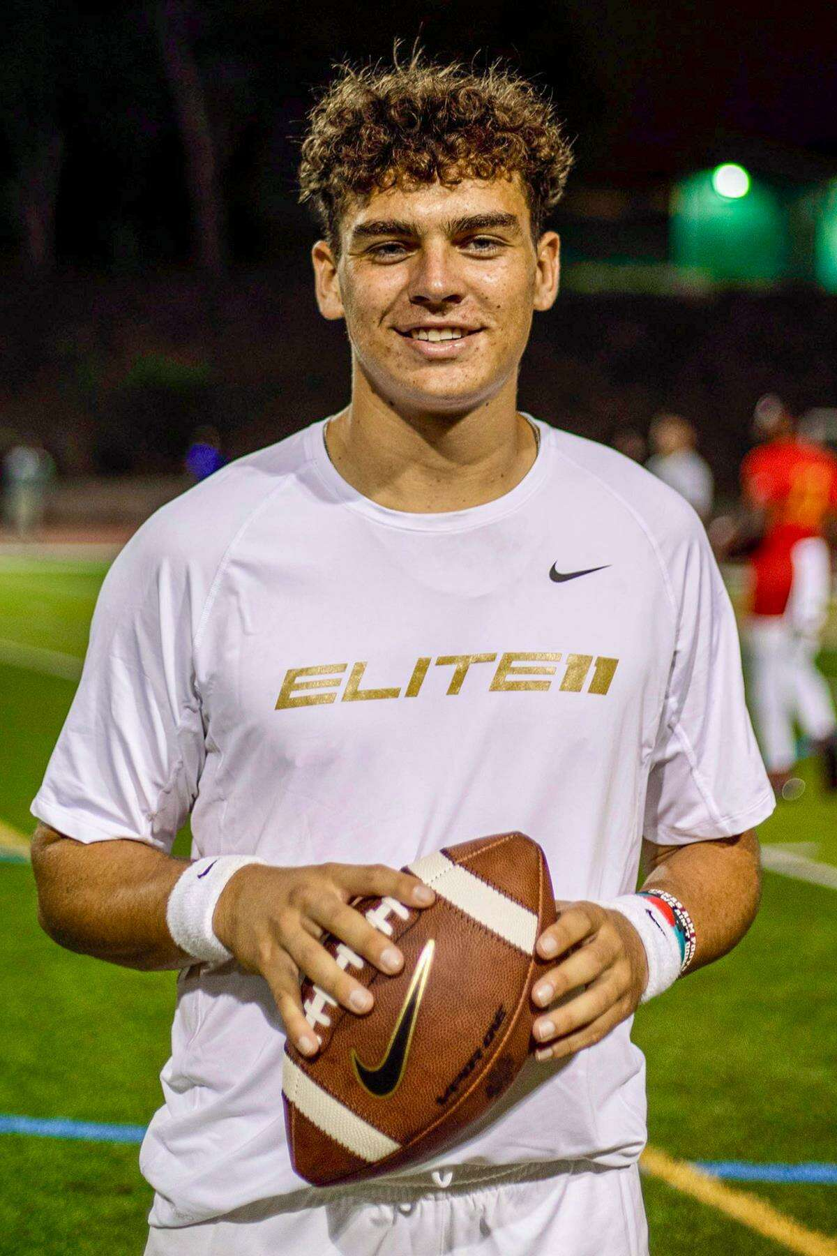 Bridgeland High School senior Conner Weigman, right, was named to the 2021 Elite 11, becoming just the sixth Houston-area football standout to earn the prestigious honor. The Elite 11 is the nation's premier quarterback competition.