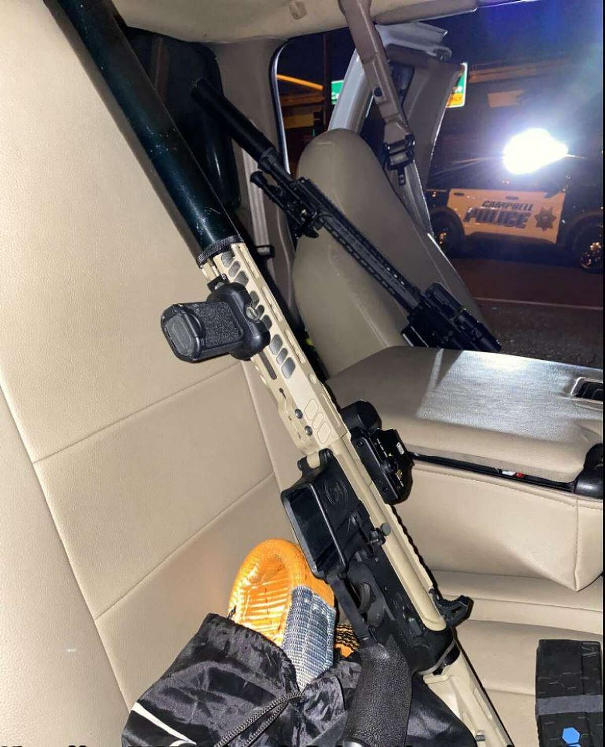 Campbell police said they found weapons, body armor and ammunition inscribed with disturbing messages in a truck being driven by a Los Gatos man. He has been charged with a variety of weapons and drug crimes.