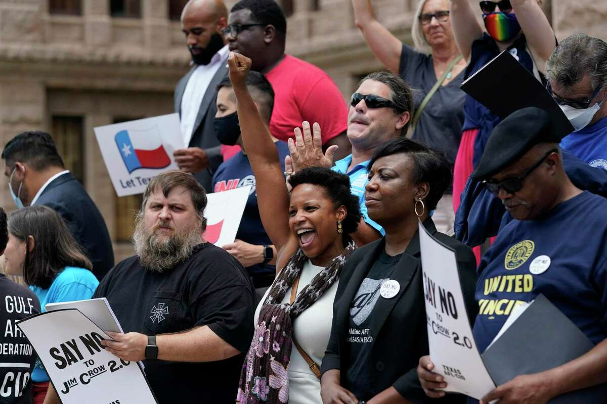 Demonstrators protest proposed voting bill on the steps of the Texas Capitol, Tuesday, July 13, 2021, in Austin, Texas. Texas Democrats left the state to block sweeping new election laws, while Republican Gov. Greg Abbott threatened them with arrest the moment they return. (AP Photo/Eric Gay)