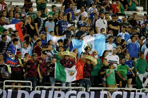 Mexico and Guatemala fans cheer for their teams during the first half of a CONCACAF Gold Cup Group A soccer match in Dallas, Wednesday, July 14, 2021. (AP Photo/Michael Ainsworth)