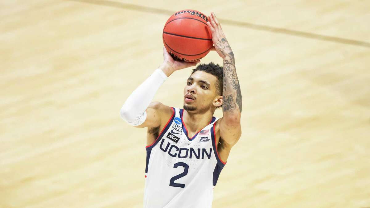 Connecticut's James Bouknight (2) shoots a free throw during a first-round game against Maryland in the NCAA men's college basketball tournament, Saturday, March 20, 2021, at Mackey Arena in West Lafayette, Ind. Maryland won 63-54. (AP Photo/Robert Franklin)