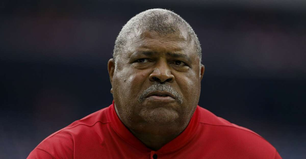 Houston Texans defensive coordinator Romeo Crennel walks in to the locker room before the start an NFL game against the Denver Broncos at NRG Stadium Sunday, Dec. 8, 2019, in Houston.