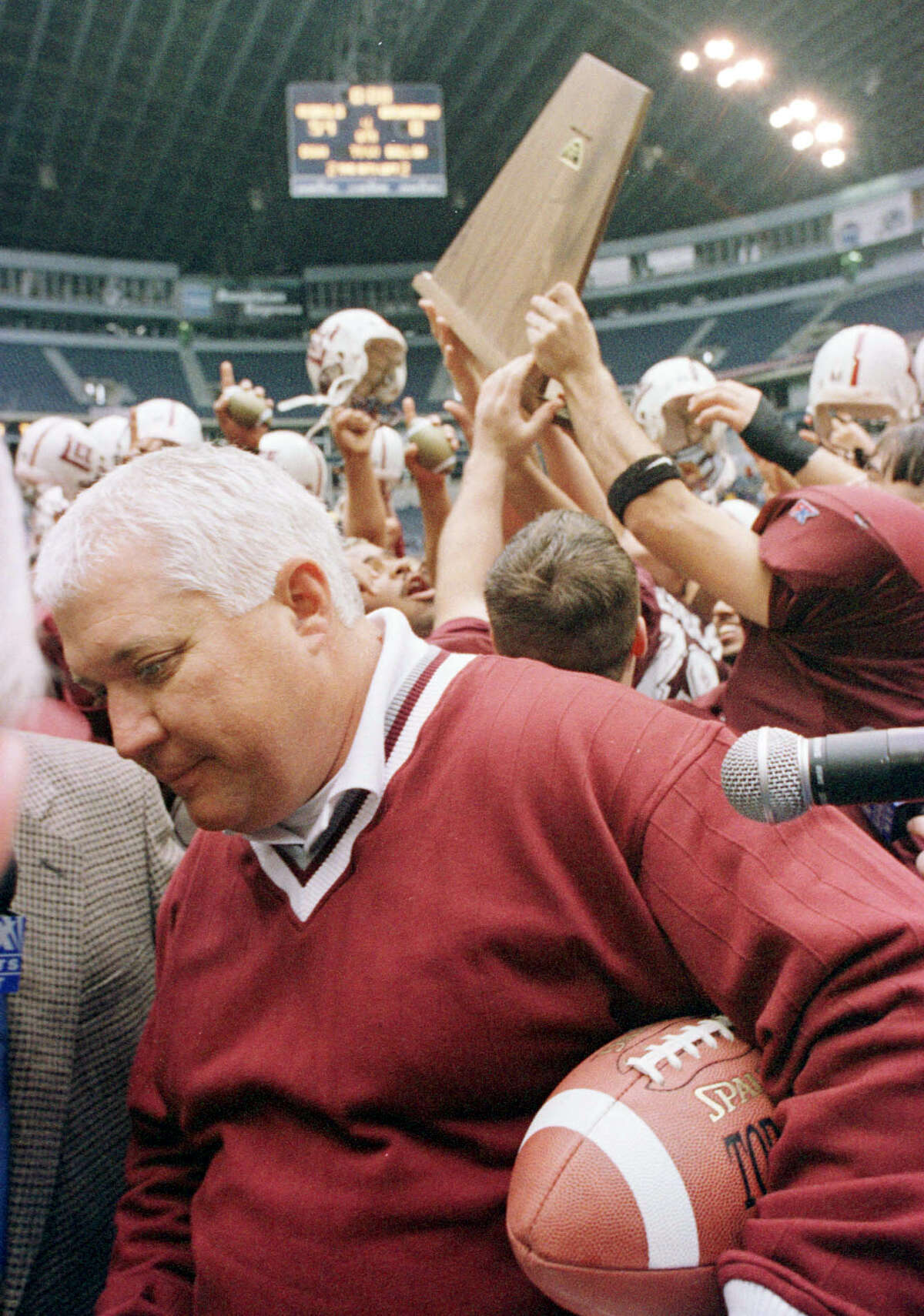 In Texas Stadium in Dallas Saturday Dec. 19, 1998, Midland Lee High School head football coach John Parchman is seen in the victory circle after defeating San Antonio's MacArthur High School . HOUCHRON CAPTION (04/29/2001): John Edd Parchman - in the victory circle after Midland Lee High School's football team defeated San Antonio's MacArthur High School in December 1998 - is an example of the kid-sensitive type of coach.