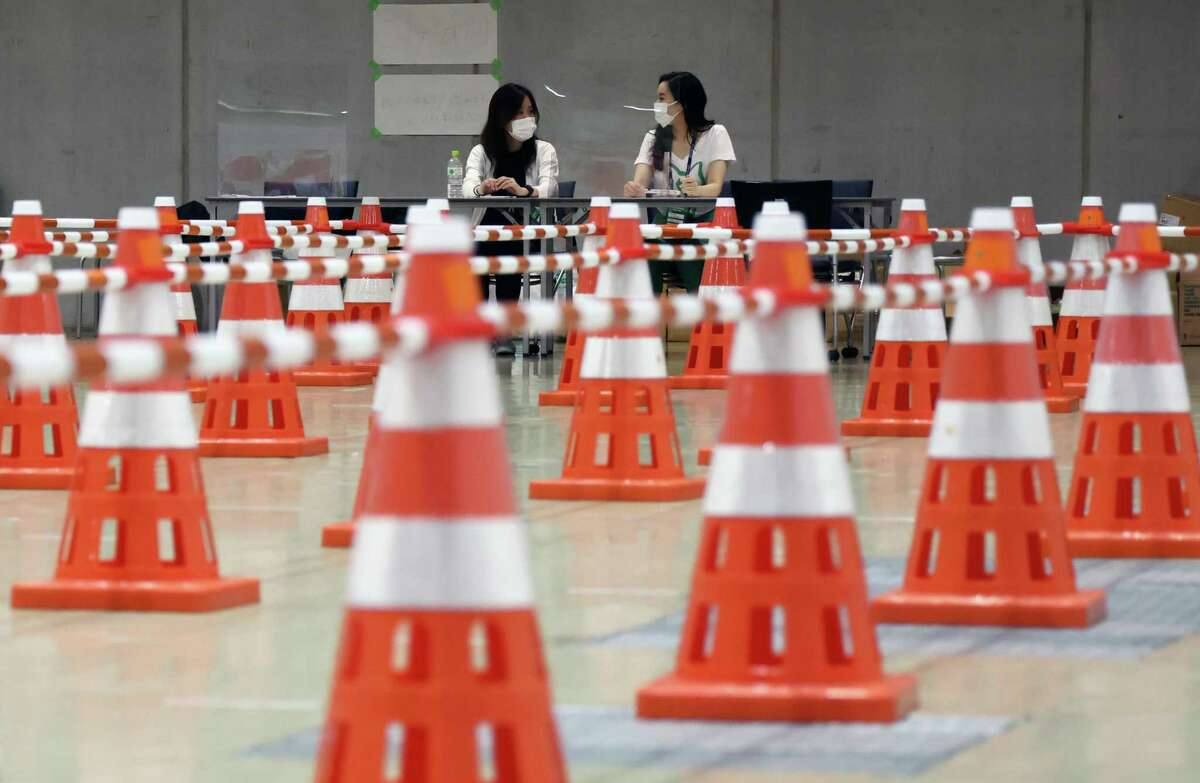 Safety cones in a hall where journalists are tested for the coronavirus at the Tokyo Olympics main press center.