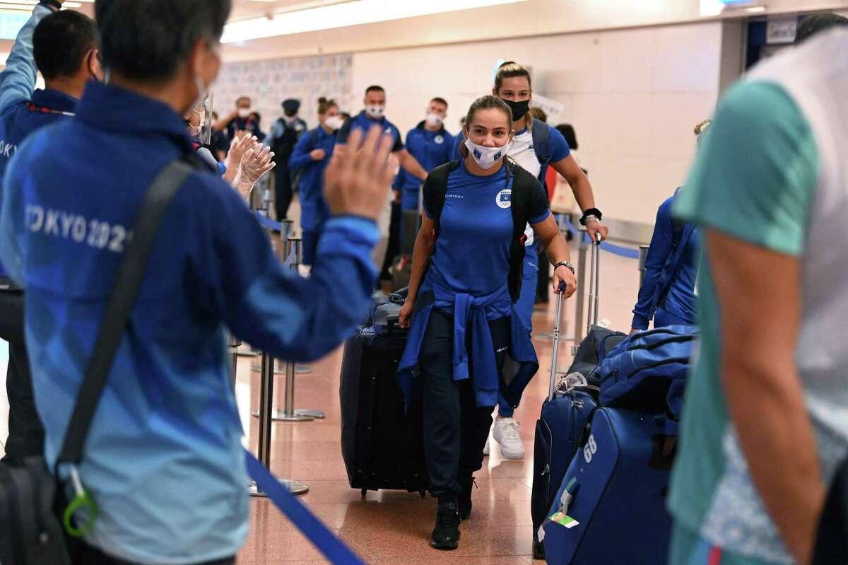 Majlinda Kelmendi of Kosovo (center), 2016 Rio Olympic Judo gold medalist, arrives with her teammates Thursday at Tokyo International Airport.