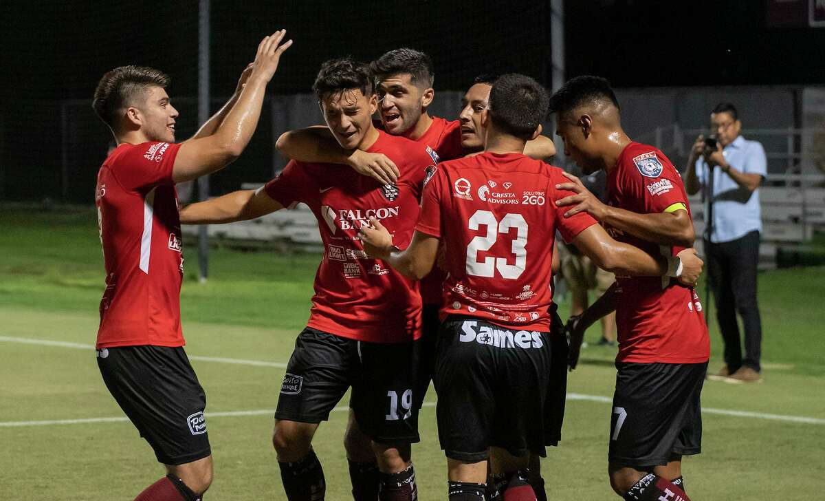 Riccardo Turcis celebrates with teammates after scoring one of his two goals in the Heat's 3-0 victory over the Midland-Odessa Sockers FC on Wednesday at the TAMIU Soccer Complex in the Lone Star Conference semifinals.