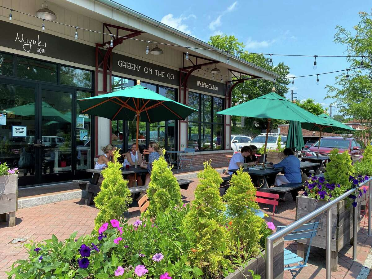 New Canaan boasts over 40 restaurants many thriving after the pandemic. People sat outside Pine Street Concessions around noon on July 15, 2021.