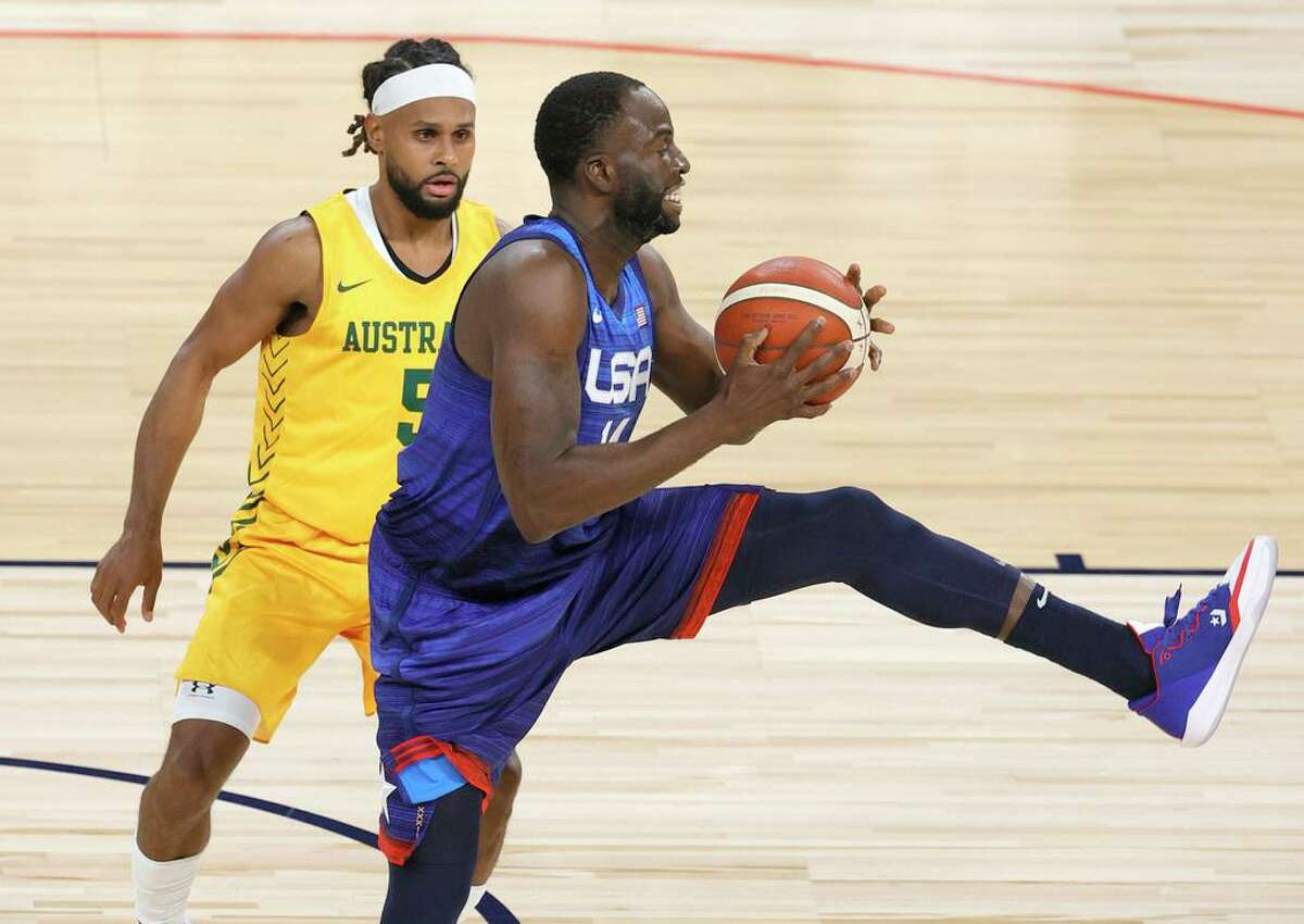 LAS VEGAS, NEVADA - JULY 12: Draymond Green #14 of the United States catches a pass against Patty Mills #5 of the Australia Boomers during an exhibition game at Michelob Ultra Arena ahead of the Tokyo Olympic Games on July 12, 2021 in Las Vegas, Nevada. (Photo by Ethan Miller/Getty Images)