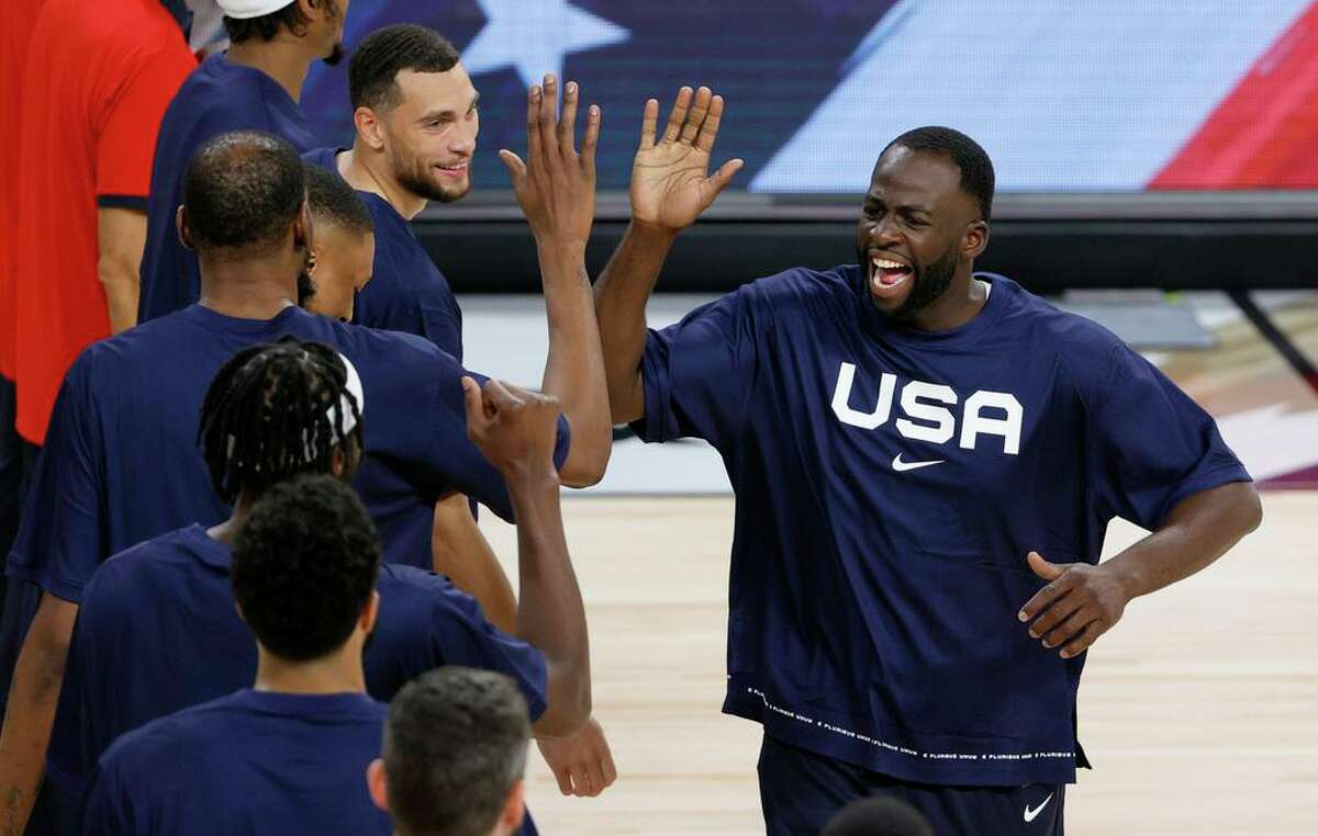LAS VEGAS, NEVADA - JULY 10: Draymond Green #14 of the United States high-fives Kevin Durant #7 during player introductions before an exhibition game against Nigeria at Michelob ULTRA Arena ahead of the Tokyo Olympic Games on July 10, 2021 in Las Vegas, Nevada. Nigeria defeated the United States 90-87. (Photo by Ethan Miller/Getty Images)