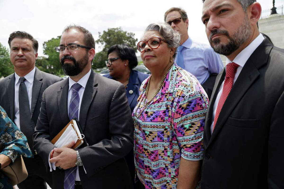 State Reps. Joe Moody (second from the left), Toni Rose and Senfronia Thompson and state Sen. Cesar Blanco speak to reporters after a meeting with U.S. Sen. Joe Manchin at the U.S. Capitol on Thursday, July 15, 2021 in Washington, DC.