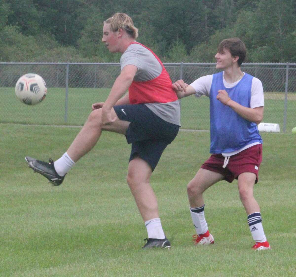 Big Rapids' Brady Fox (left) works with the ball on Wednesday during an open field session at the practice field. (Pioneer photo/John Raffel)