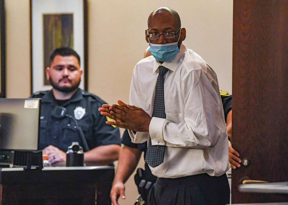 Otis McKane enters the 379th District Court room on Thursday, July 15, 2021, for the fourth day of his capital murder trial in the killing San Antonio police Detective Ben Marconi on Nov. 20, 2016.