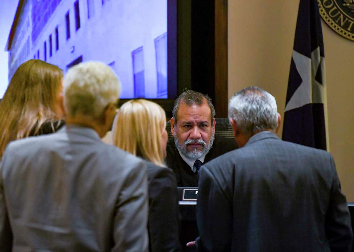Judge Ron Rangel speaks with attorneys on both sides on Thursday, July 15, 2021, during the fourth day of the capital murder trial of Otis McKane, who is accused of killing San Antonio police Detective Ben Marconi on Nov. 20, 2016.
