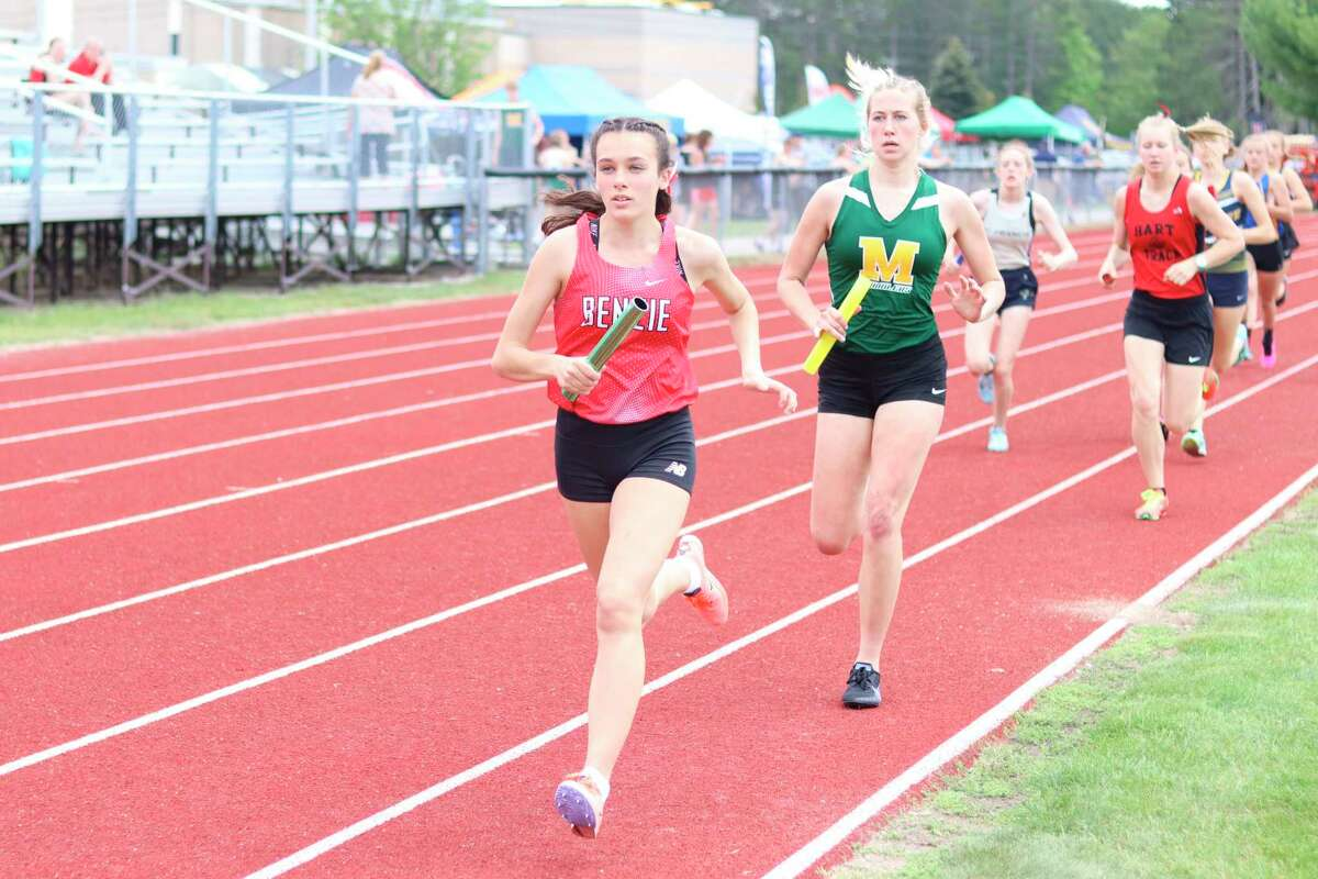 Cierra Guay races in the 4x800-meter relay for the Huskies at regionals this spring. (Record Patriot file photo)