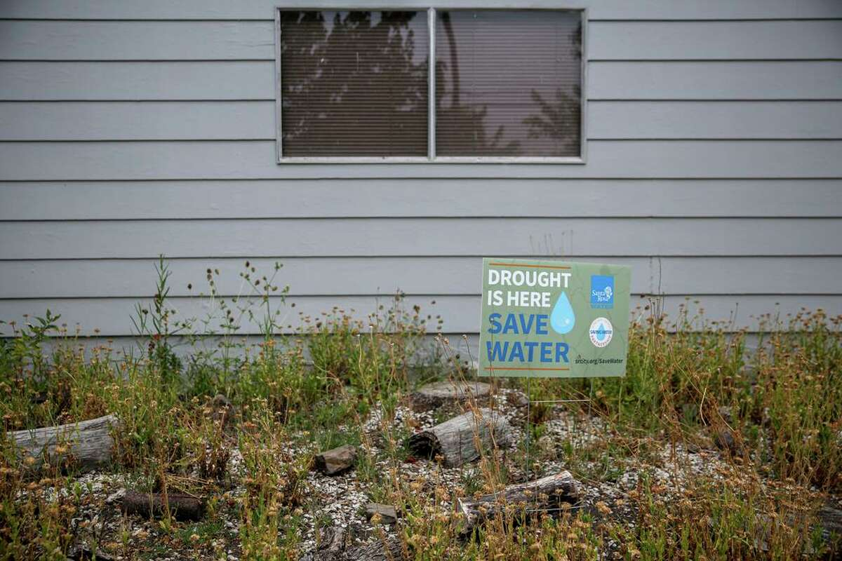 A sign advises residents to save water outside a residence in Santa Rosa.