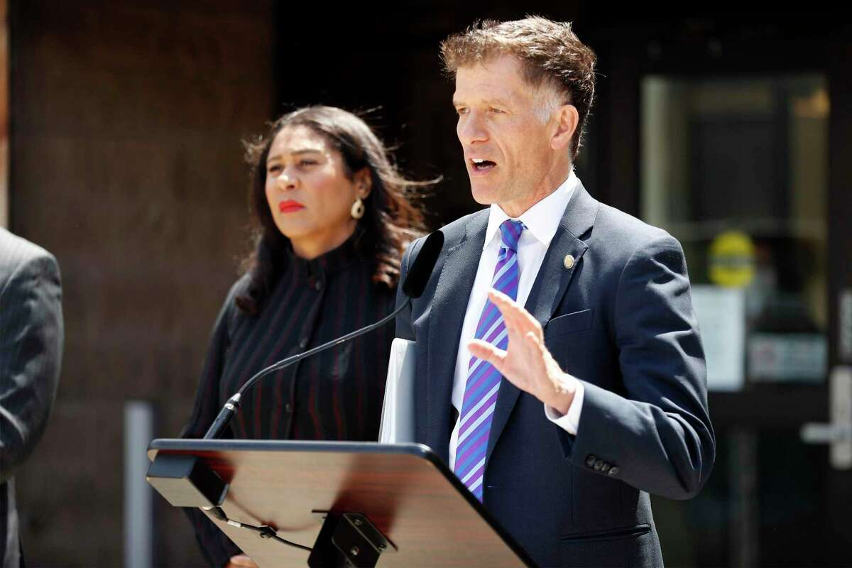 Director of Public Health Dr. Grant Colfax (right) joins San Francisco Mayor London Breed in encouraging SF residents to get vaccinated during a press conference at Southeast Health Center in the Bayview neighborhood of San Francisco, Calif., on Thursday, July 15, 2021.